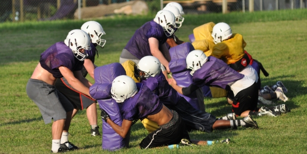 In a tackling drill called the crocodile roll, Brentwood players (right) grab dummies and pull them to the ground. It was the second day of an eight-day camp that runs from July 13-16 and July 20-23 at Mount Calvary Lutheran Church. (All photos by Steve Bowman)