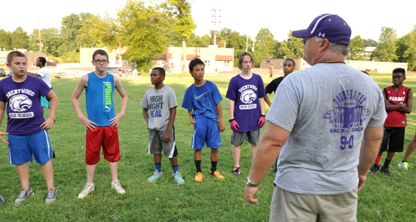 John Sappington has players line up for an exercise at the Brentwood Junior Eagles minicamp last week at Norm West Park. Sappington directed the three-day camp and is head coach of the eighth-grade team. (All photos by Steve Bowman)