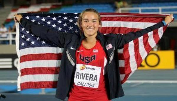 Sophia Rivera holds the American flag after winning a silver medal in the shot put at the.