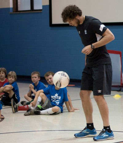 Heinemann demonstrates his foot skills for campers. (Photo by Caroline Wiley)