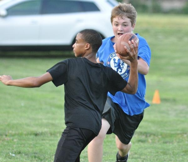 John Doe puts pass rush pressure on quarterback Josh Danfort.
