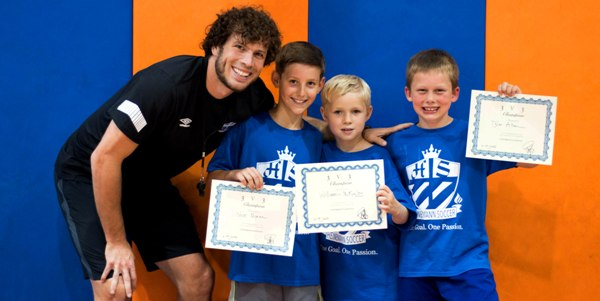Tommy Heinemann poses with the winning team of the three-on-three competition at his soccer camp in Brentwood last month. The winners are (from left) Nick Moran, William McKinley and Tyler Allen. (Photo by Caroline Wiley)