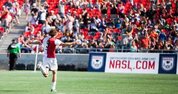 Heinemann encourages the crowd at an Ottawa Fury FC game in Ontario, Canada.