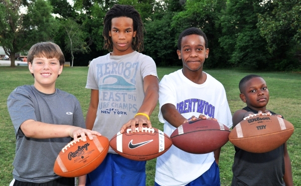 Winners of a passing competition at the Junior Eagles' 2014 summer camp are (from left) sixth grader Tom Suntrup, eighth grader Jordan Tate, seventh grader Reggie Jeffrey and fifth grader Justin Erby-Carr. (Photo by Steve Bowman)