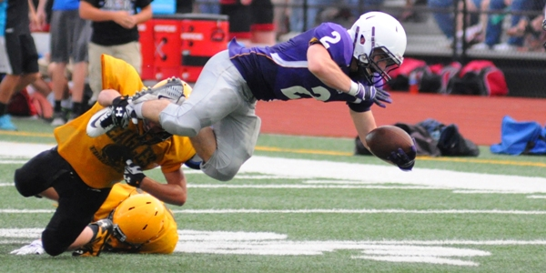 Jacob Clay fights for yardage in the preseason jamboree in 2014. As a junior that year he set school records for rushing yards in a season and in a game, and for most touchdowns in a season. (Photo by Steve Bowman)