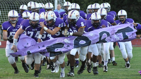 The BHS football team takes the field before a game in 2013, led by (from left) John Surgener, Connor Hancock, Jake Zivic, Devon Couch and Demetrius Graves. (Photo by Steve Bowman)