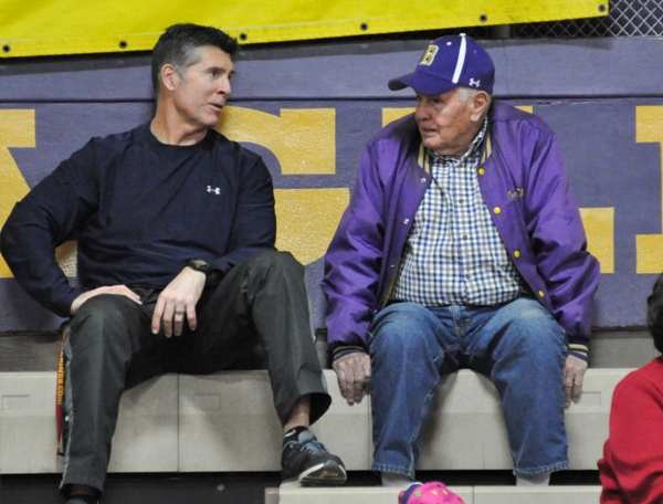 Current football coach Keith Herring (left) chats with former coach John Titus (1958-73) at a basketball game in 2014. (Photo by Steve Bowman)
