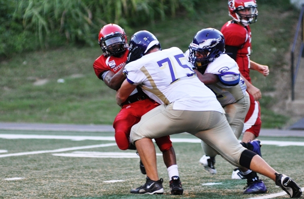 David Rivera (75) drives back a Crystal City ball carrier. He made first team all-state as a defensive lineman in 2012. (Photo by Steve Bowman)