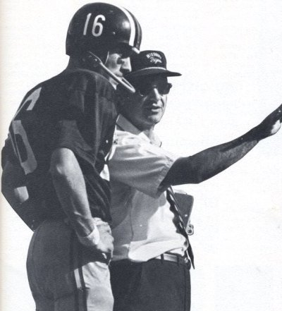 Quarterback Chuck Roper listens to Mizzou head coach Dan Devine in 1970, the year he passed for 1,097 yards. He played in 32 games for the Tigers from 1969-71.