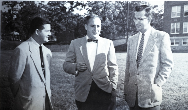 In 1955, head coach Walter Marsh (center) speaks with freshman coach Bill Long (left) and backfield coach John Lauer. Head coach from 1950-53, Lauer orchestrated Brentwood's first winning season. He then handed the reins to Marsh, who went four years in a row without a losing season. (Photo from 1956 BHS yearbook)