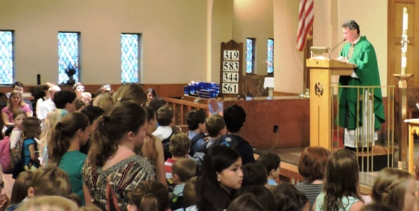 Students and parishioners of Saint Mary Magdalen attend a special Backpack Blessing , Sunday morning, August 16 at Saint Mary Magdalen Catholic Church.