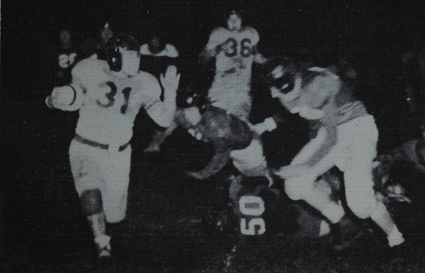 Kurt Herrmann sweeps right in 1947. Though one of the shortest team members, Herrmann was stocky and powerful and led the team in scoring. (Photo from 1948 BHS yearbook)