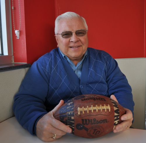 Former BHS head coach Bob Penn holds the football his team signed for him after winning the conference in 1982. This photo is from 2014 when he was inducted into the Missouri Sports Hall of Fame. (Photo by Steve Bowman)
