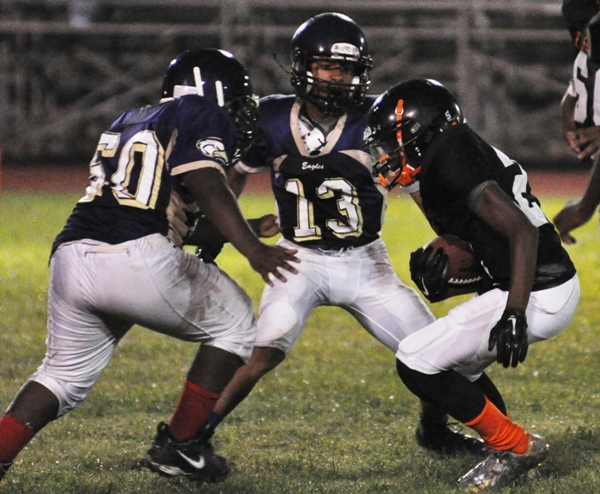 Kyle Fair (left) and Marco Mathon trap a Webster Groves rusher.