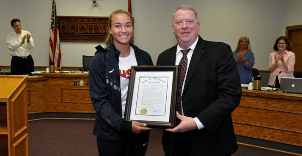 Brentwood Mayor Chris Thornton presents a city proclamation to Sophia Rivera on Monday at the Board of Aldermen meeting. (Photo by Steve Bowman)