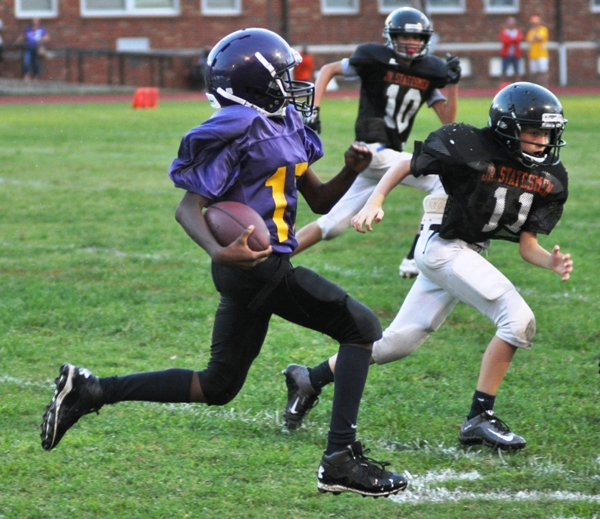 Seventh grader Chris Brown breaks loose for a long gain against Webster Groves.