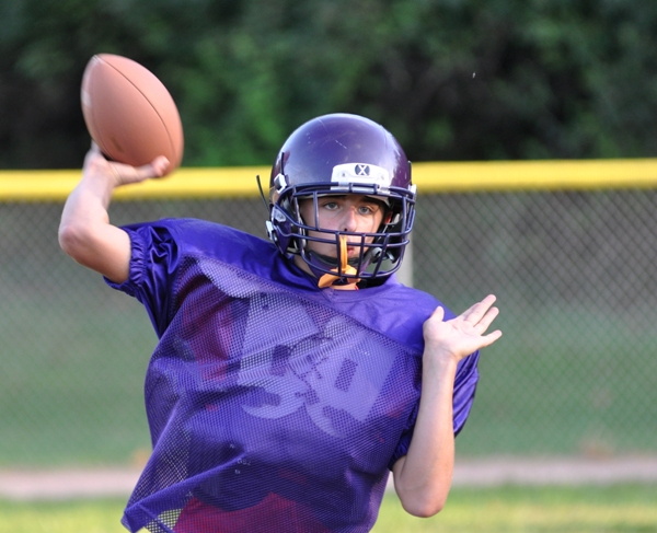 Nathan Butler quarterbacks the eighth-grade team.