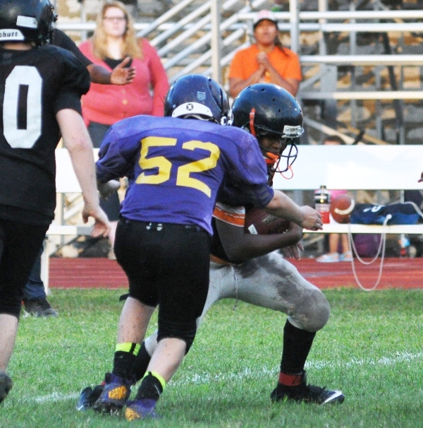 Seventh grader Thomas Suntrup tackles a Webster Groves ball carrier for a loss.
