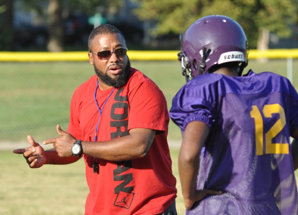 Coach Fred Brown runs a pratice session on playing on the defensive line.