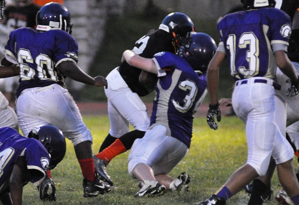 Tristan Jones brings down a Webster Groves running back as Kyle Fair (60) arrives.
