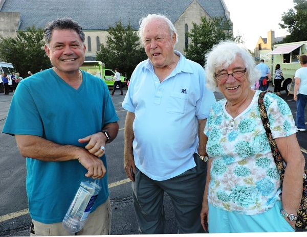 Father Jack Siefert of Saint Mary Magdalen Catholic Church chats with food festival participants. (Photo by Tina Hogan)