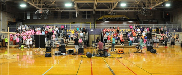 The students fill most of the seats on the north side of the BHS gym.