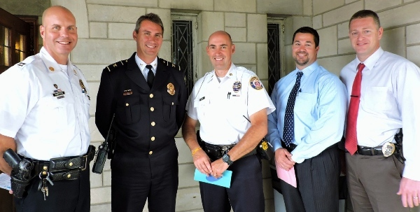 Among the first responders attending the Feast of the Archangels service at St. Mary Magdalen Catholic Church on Sept. 30 are (from left): Capt. Doug Schaefler, Richmond Heights Police Dept.; Chief Jeff Beaton, Glendale PD; Maj. Jim McIntyre, Brentwood PD; Detective Sgt. Jason Simpson, Brentwood PD; and Detective Sgt. Gerry Rohr, Richmond Heights PD. (Photo by Tina Hogan)