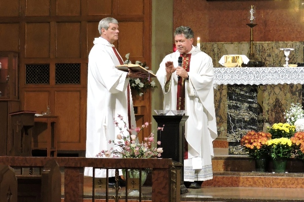 Conducting the service are Father ____ (left) and Father Jack Siefert. (Photo by Tina Hogan)