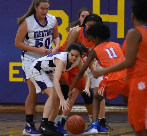 Amanda Ingersoll reaches for a loose ball along with Clayton's Tyra Edwards.