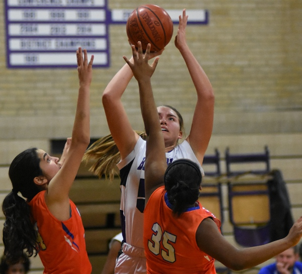 Sophia Rivera launches a shot over Clayton's Jill Jones (left) and Kaitlyn White.