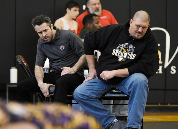 Assistant coach Mic Boshans (left) and head coach Roy Hughes watch Chase Lynch defeat James Pyle-McGlynn of Herculaneum.