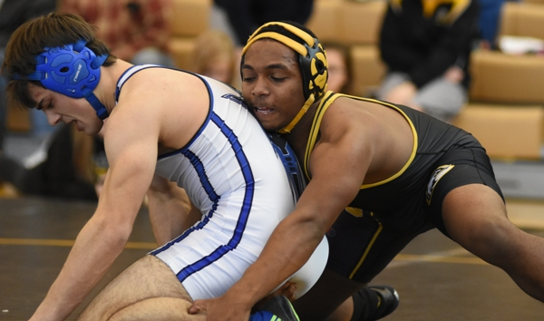 Gary Silerio attacks MRH's Matt Green in the match for first place at 145 pounds. Silerio lost 3-2.