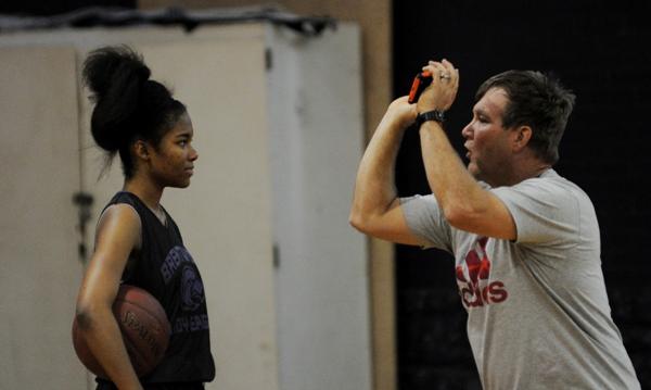Chris Jones talks to Nija Price about shooting form on Jan. 2.