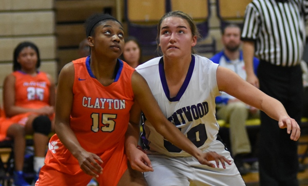 Sophia Rivera and Clayton's Tatianna Benford fight for position during a free throw.
