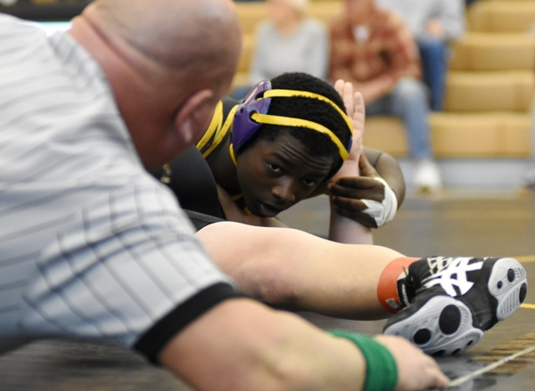 Tayveon Brown closes in on a pin of Herculaneum's Justin Montgomery at Vianney.