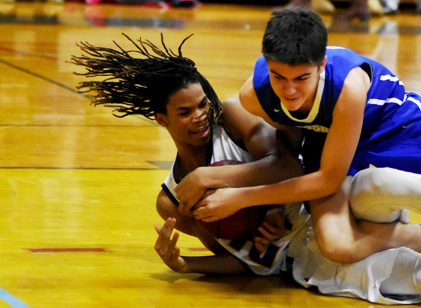 Jordon Tate (left) fights for a loose ball.