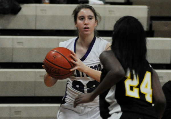 Gabby Gombas looks for an open teammate against McKinley.
