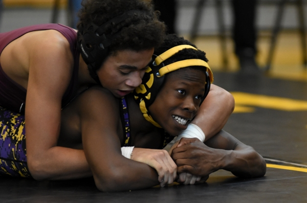 Zach Arrindell (right) considers his narrow options against Sumner's Keith Clay at Vianney.