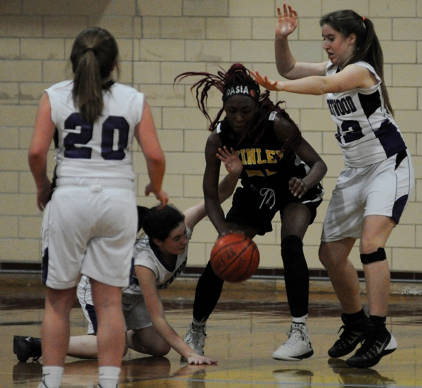 Amanda Ingersoll goes to the floor for a loose ball in the McKinley game.