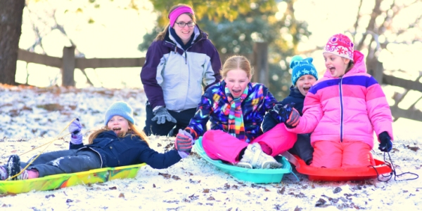 Jessica White watches her daughters and their friends attempt to descend Oak Tree Park hill in a sled caravan. The girls are (from left) Haven White, Amelia Spencer, Emily Greene and Avery White. (All photos by Steve Bowman)