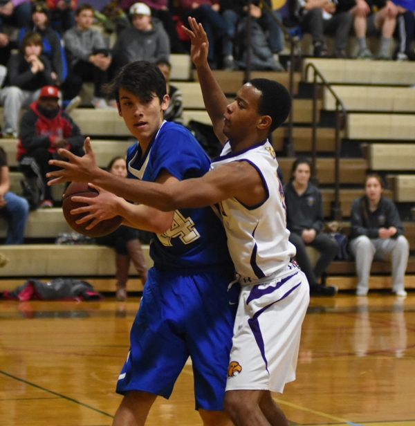 Justice Harris tries to get the ball from Jim Smith of Crossroads.
