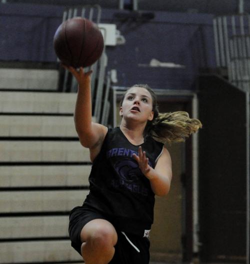 Megan Jones practices her layup in practice.