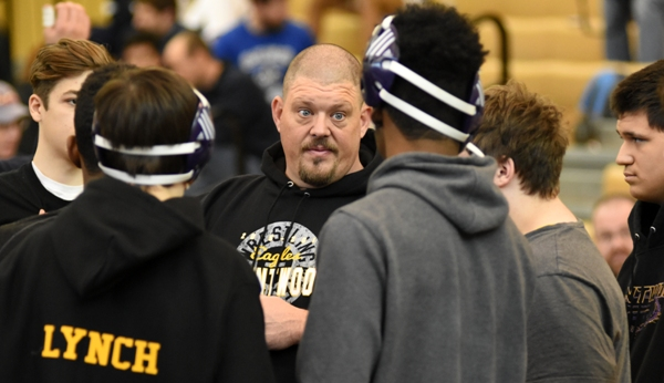Brentwood head coach Roy Hughes talks to his wrestlers between sessions at the Vianney Tournament.