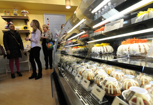 Bundt cakes of various sizes fill the display case.