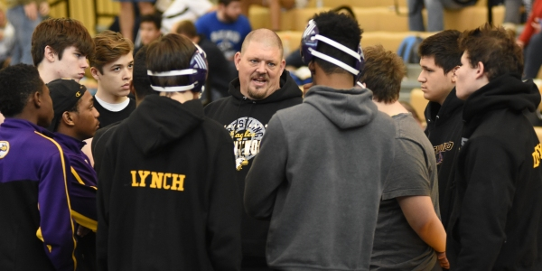 Brentwood coach Roy Hughes talks to his wrestlers before the final rounds at St. John Vianney Saturday in Kirkwood. (All photos by Steve Bowman)