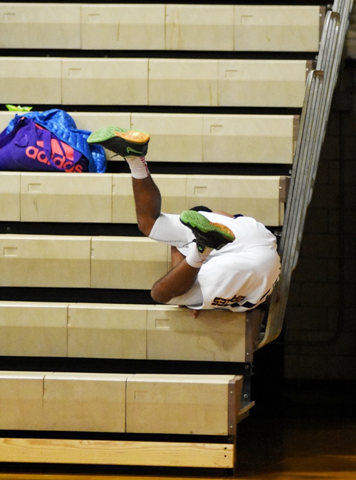 Justice Harris chases a ball into the bleachers.