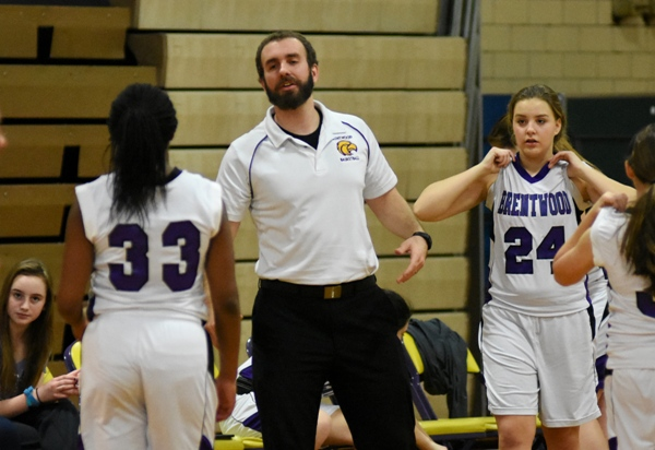 Assistant coach Andy Nieters praises Marshelle Franklin at the end of the first half against Clayton. The Eagles took an early lead and trailed by only a few points throughout the half.