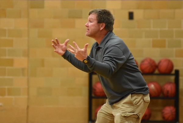 Brentwood coach Chris Jones, above and below, wonders why his team is starting so slowly against Kennedy, scoring only 4 points in the first quarter.