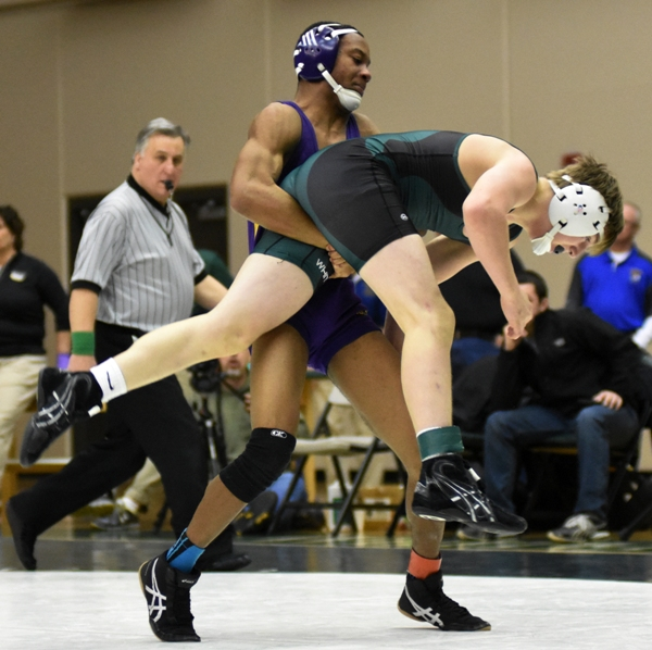 Justin Harris lifts Ethan Hovis of Whitfield, who won the match 11-6.