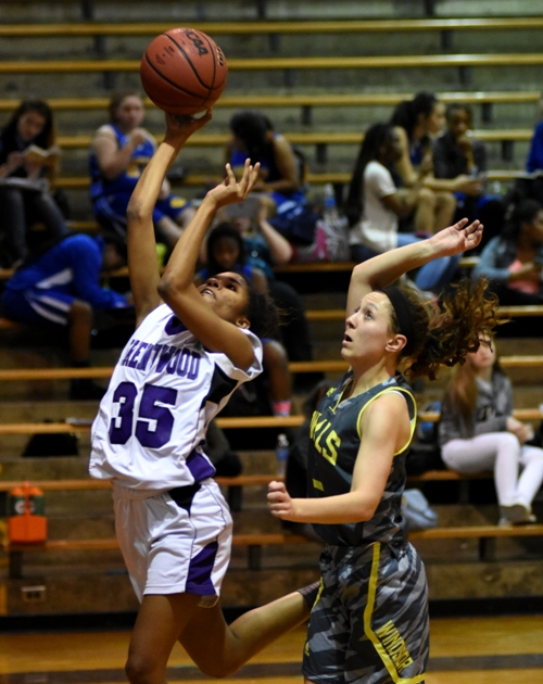 Nija Price goes in for a layup against Windsor.